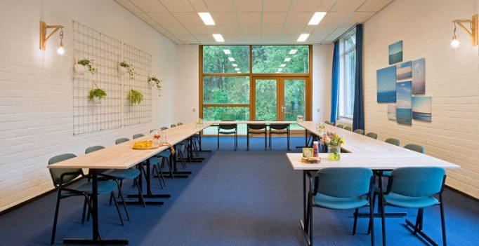 Vergaderen in een zaal